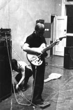 """Група називалась """"LYP"""" (Laugh of Young Physics) та проіснувала досить довго - приблизно до початку 90-х. Фото зроблено приблизно в 1973-1974 роках. під час репетиції ВІА в актовому залі ФТФ. Налагоджує апаратуру Андрій Малик, із гітарою – Анатолій Блінкін"""